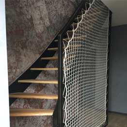 Stairway banister with steel frame and vertical safety net
