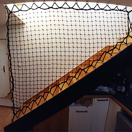 Patio railing made to knotted black netting