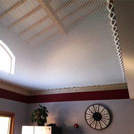 Suspended indoor net over living room space